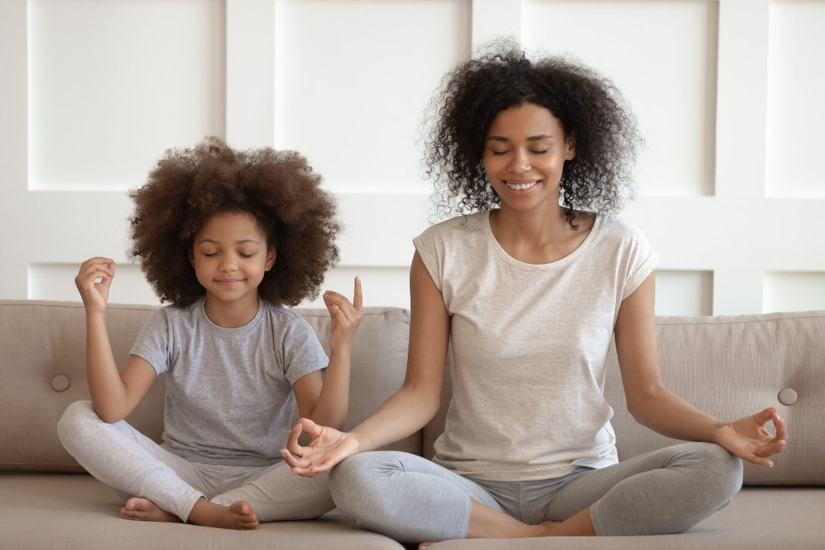 Mother and daughter meditate