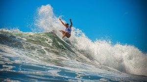 Summer Macedo surfing